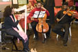 A string trio filled the station with wonderful music.